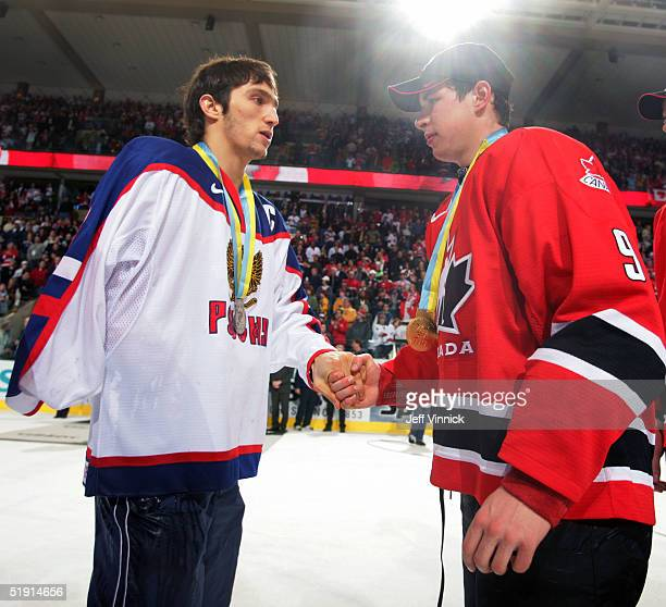 Sidney Crosby of Canada and Alexander Ovechkin of Russia shake hands after Canada won the gold medal game 61 over Russia at the World Junior Hockey...