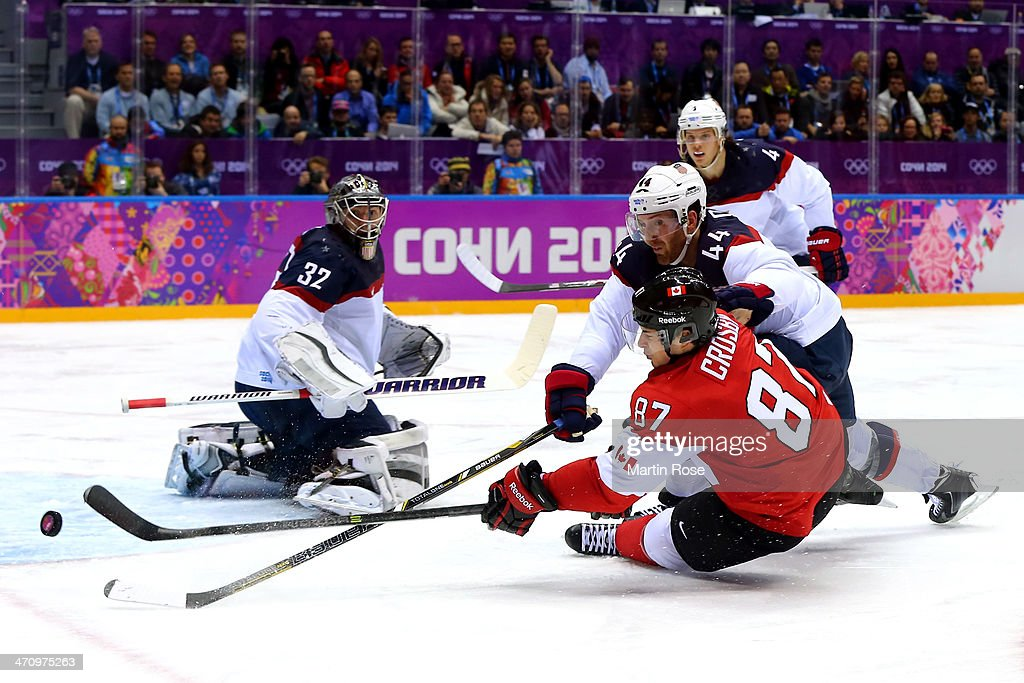 <a gi-track='captionPersonalityLinkClicked' href=/galleries/search?phrase=Sidney+Crosby&family=editorial&specificpeople=212781 ng-click='$event.stopPropagation()'>Sidney Crosby</a> #87 of Canada attempts to score against <a gi-track='captionPersonalityLinkClicked' href=/galleries/search?phrase=Brooks+Orpik&family=editorial&specificpeople=213074 ng-click='$event.stopPropagation()'>Brooks Orpik</a> #44 and <a gi-track='captionPersonalityLinkClicked' href=/galleries/search?phrase=Jonathan+Quick&family=editorial&specificpeople=2271852 ng-click='$event.stopPropagation()'>Jonathan Quick</a> #32 of the United States during the Men's Ice Hockey Semifinal Playoff on Day 14 of the 2014 Sochi Winter Olympics at Bolshoy Ice Dome on February 21, 2014 in Sochi, Russia.
