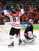 Sidney Crosby of Canada celebrates after scoring the matchwinning goal in overtime whilst a dejected Ryan Miller of the United States looks on during...