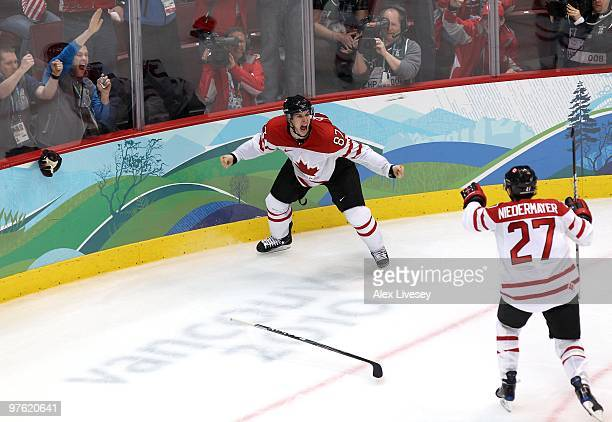 Sidney Crosby of Canada celebrates with teammate Scott Niedermayer after Crosby scored the matchwinning goal in overtime during the ice hockey men's...
