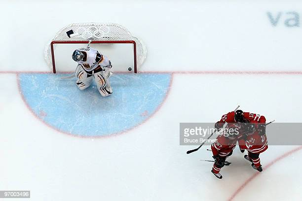 Sidney Crosby of Canada celebrates with teammates after he scored a goal in the third period against goalie Thomas Greiss of Germany during the ice...