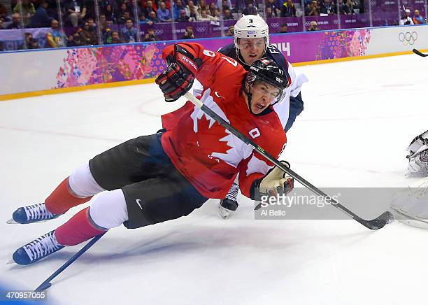 Sidney Crosby of Canada falls to the ice during the Men's Ice Hockey Semifinal Playoff against the United States on Day 14 of the 2014 Sochi Winter...