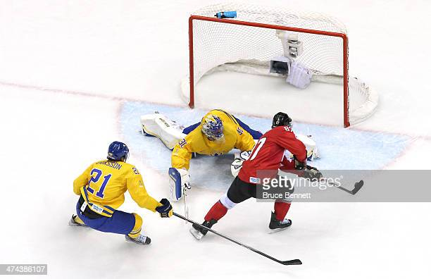 Sidney Crosby of Canada scores a goal against Henrik Lundqvist of Sweden as Loui Eriksson of Sweden looks on during the Men's Ice Hockey Gold Medal...
