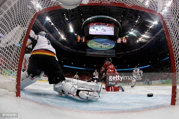 Sidney Crosby of Canada scores a goal against Thomas Greiss of Germany during the ice hockey Men's Qualification Playoff game between Germany and...