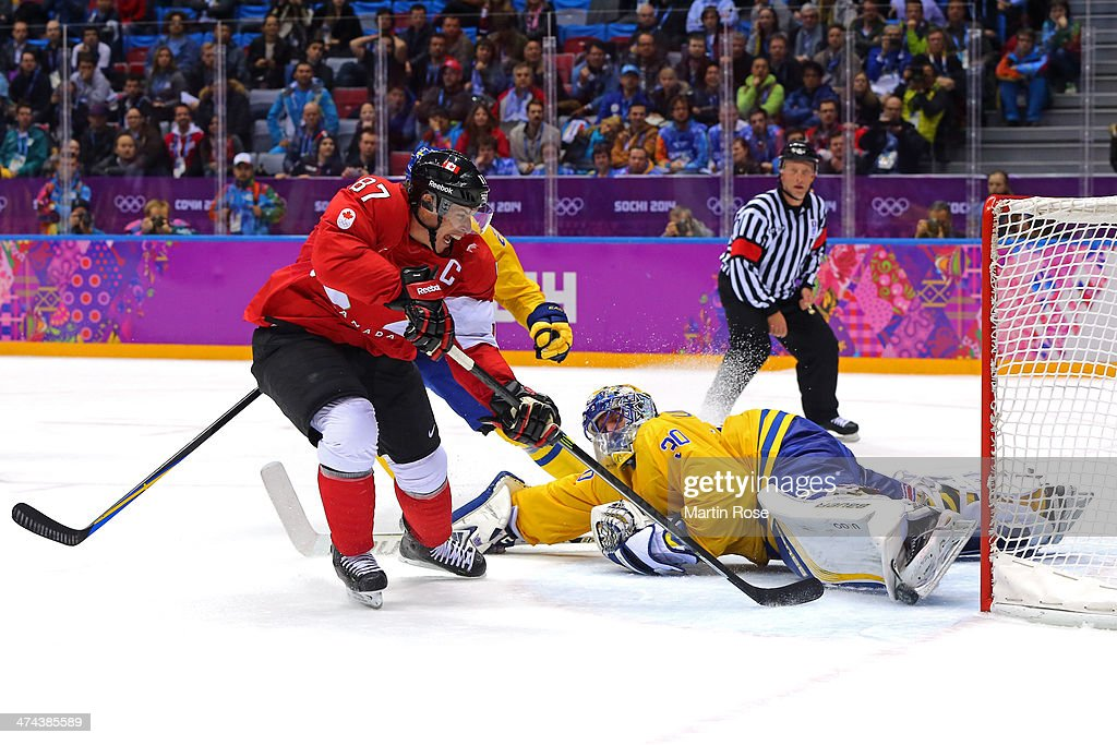 <a gi-track='captionPersonalityLinkClicked' href=/galleries/search?phrase=Sidney+Crosby&family=editorial&specificpeople=212781 ng-click='$event.stopPropagation()'>Sidney Crosby</a> #87 of Canada scores his team's second goal past Henrik Lundqvist #30 of Sweden in the second period during the Men's Ice Hockey Gold Medal match on Day 16 of the 2014 Sochi Winter Olympics at Bolshoy Ice Dome on February 23, 2014 in Sochi, Russia.