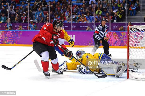 Sidney Crosby of Canada scores his team's second goal past Henrik Lundqvist of Sweden in the second period during the Men's Ice Hockey Gold Medal...