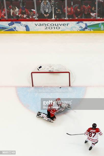 Sidney Crosby of Canada scores the gamewinning goal against Jonas Hiller of Switzerland during the ice hockey men's preliminary game between...
