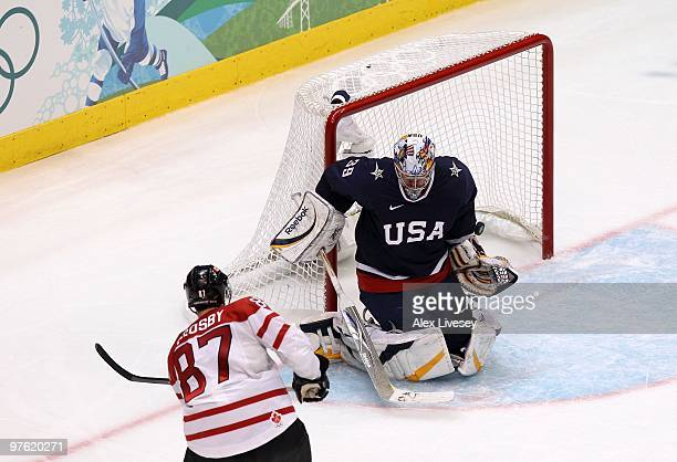 Sidney Crosby of Canada scores the gamewinning goal in overtime against Ryan Miller of USA in the ice hockey men's gold medal game between USA and...