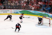 Sidney Crosby of Canada scores the matchwinning goal in overtime past Ryan Miller of the United States during the ice hockey men's gold medal game...
