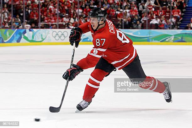 Sidney Crosby of Canada shoots the puck during the ice hockey men's preliminary game between Canada and Norway on day 5 of the Vancouver 2010 Winter...