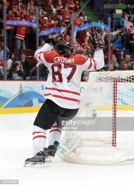 Sidney Crosby of Canada skates around the net to celebrate after scoring the matchwinning goal in the first overtime during the ice hockey men's gold...