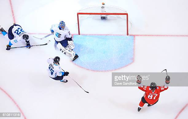 Sidney Crosby of Team Canada celebrates a goal by teammate Brad Marchand of Team Canada as Jaroslav Halak of Team Europe Nino Niederreiter of Team...