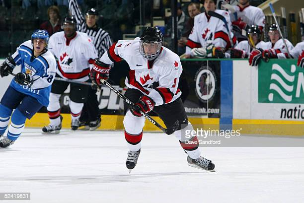 Sidney Crosby of Team Canada eyes the play as he skates against Team Finland during the World Jr Hockey tournament at the Ralph Englestad Arena on...