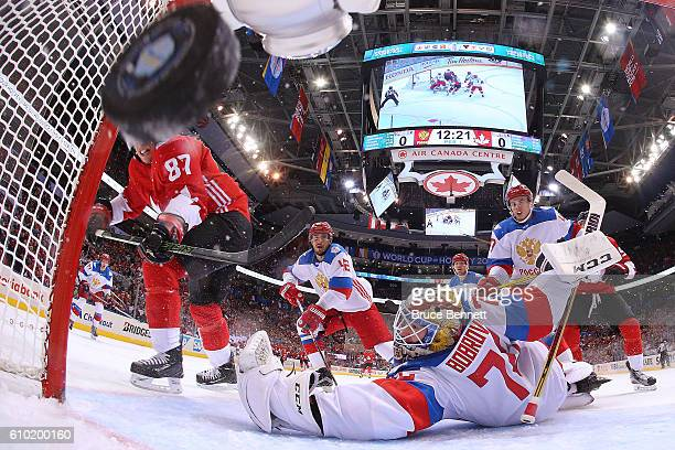 Sidney Crosby of Team Canada scores a first period goal past a diving Sergei Bobrovsky of Team Russia at the semifinal game during the World Cup of...