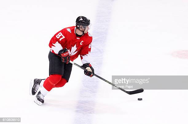 Sidney Crosby of Team Canada skates up the ice with the puck during Game One of the World Cup of Hockey final series at the Air Canada Centre on...