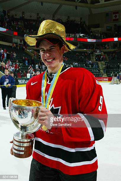 Sidney Crosby of Team Canada smiles a he holds the IIHF World Under 20 Championship trophy after the victory over Team Russia in the gold medal game...