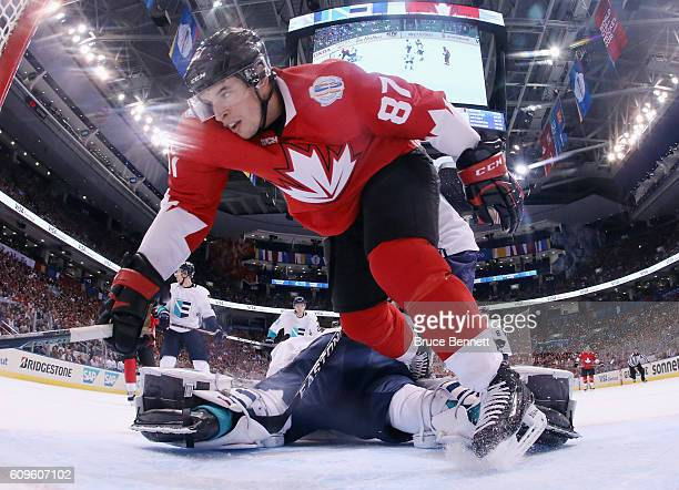 Sidney Crosby of Team Canada trips over Jaroslav Halak of Team Europe during the first period at the World Cup of Hockey tournament at the Air Canada...