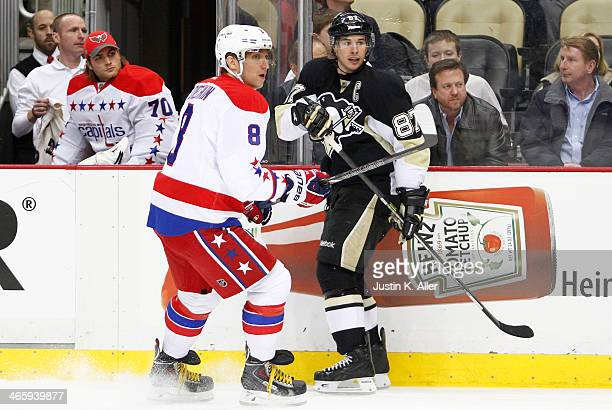 Sidney Crosby of the Pittsburgh Penguins and Alex Ovechkin of the Washington Capitals skate during the game at Consol Energy Center on January 15...