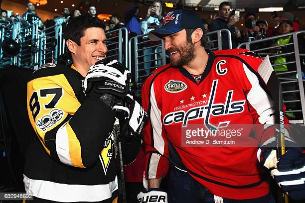 Sidney Crosby of the Pittsburgh Penguins and Alex Ovechkin of the Washington Capitals share a laugh before taking the ice for the 2017 Coors Light...