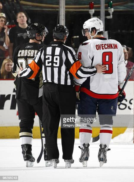 Sidney Crosby of the Pittsburgh Penguins and Alex Ovechkin of the Washington Capitals talk with referee Ian Walsh on April 6 2010 at Mellon Arena in...
