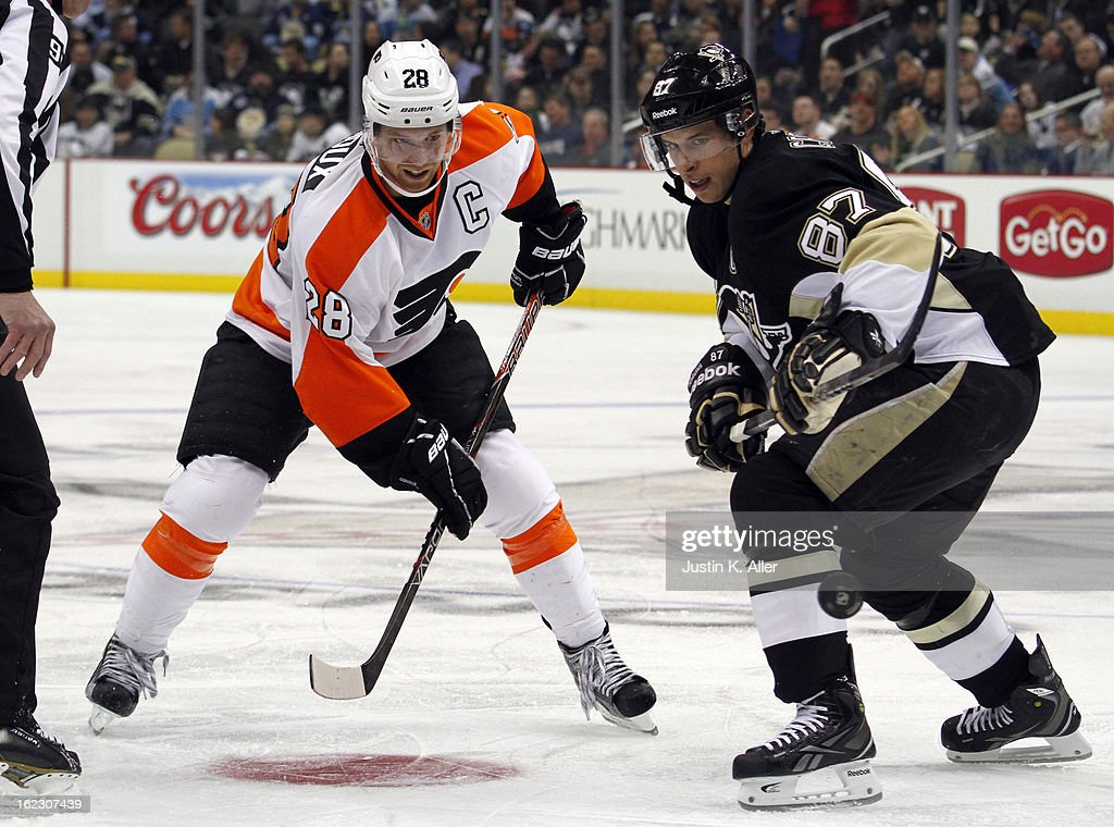Sidney Crosby #87 of the Pittsburgh Penguins and Claude Giroux #28 of the Philadelphia Flyers take a face-off during the game at Consol Energy Center on February 20, 2013 in Pittsburgh, Pennsylvania.