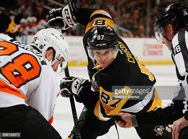 Sidney Crosby of the Pittsburgh Penguins and Claude Giroux of the Philadelphia Flyers line up for a faceoff at Consol Energy Center on January 21...