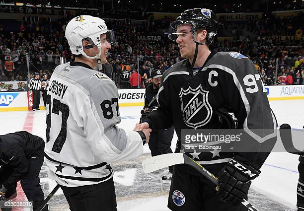 Sidney Crosby of the Pittsburgh Penguins and Connor McDavid of the Edmonton Oilers shake hands after their Metropolitan Division and Pacific Division...