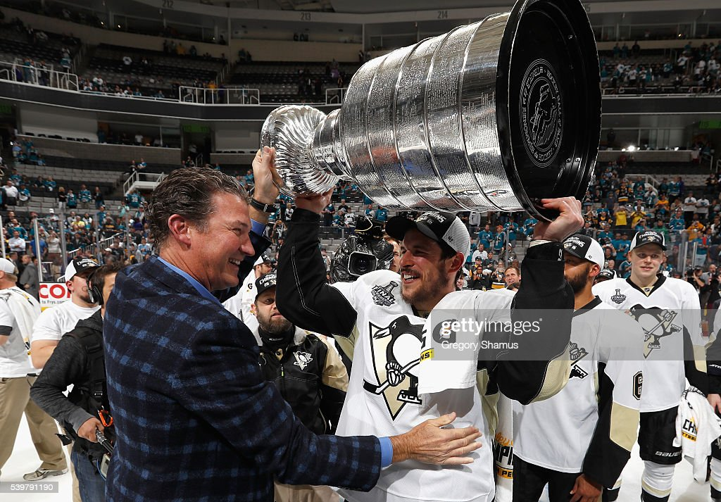 Sidney Crosby of the Pittsburgh Penguins and coowner and chairman Mario Lemieux celebrate with the Stanley Cup after the Penguins won Game 6 of the...