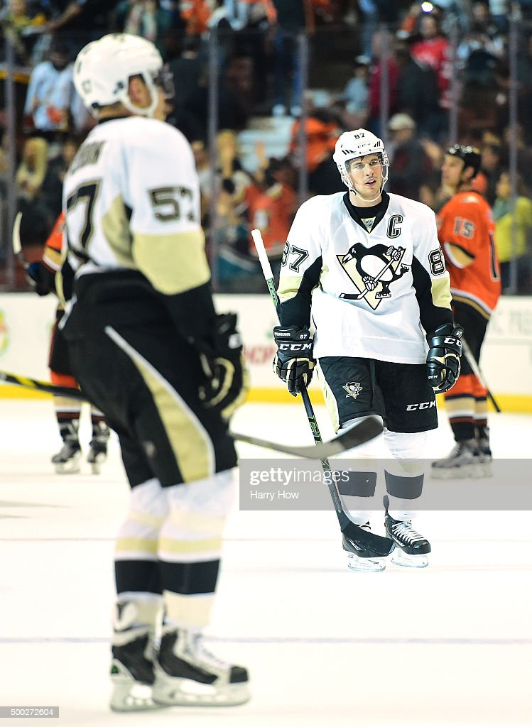 Sidney Crosby of the Pittsburgh Penguins and David Perron leave the ice after a 21 loss to the Anaheim Ducks at Honda Center on December 6 2015 in...