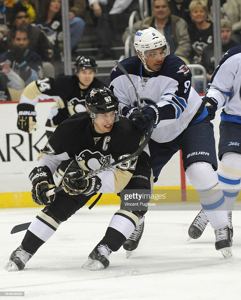 Sidney Crosby #87 of the Pittsburgh Penguins and Evander Kane # 9 of the Winnipeg Jets battle for position during the first period on February 28, 2013 at the CONSOL Energy Center in Pittsburgh, Pennsylvania.
