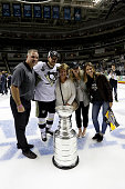 Sidney Crosby of the Pittsburgh Penguins and his family celebrate with the Stanley Cup after the Penguins 31 victory to win the Stanley Cup against...
