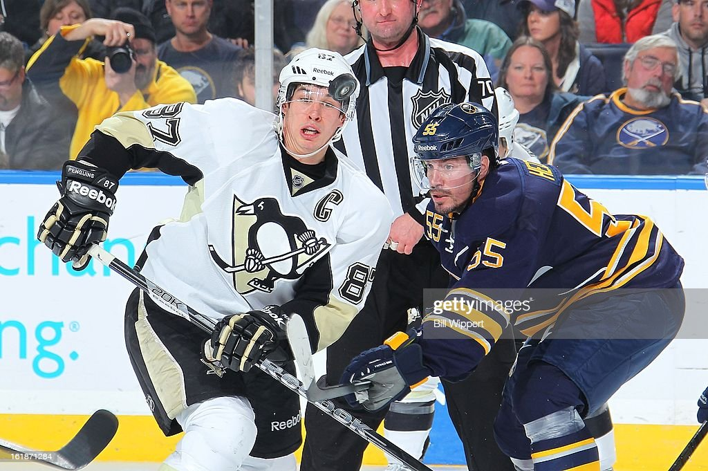 <a gi-track='captionPersonalityLinkClicked' href=/galleries/search?phrase=Sidney+Crosby&family=editorial&specificpeople=212781 ng-click='$event.stopPropagation()'>Sidney Crosby</a> #87 of the Pittsburgh Penguins and <a gi-track='captionPersonalityLinkClicked' href=/galleries/search?phrase=Jochen+Hecht&family=editorial&specificpeople=203184 ng-click='$event.stopPropagation()'>Jochen Hecht</a> #55 of the Buffalo Sabres follow the puck on a faceoff on February 17, 2013 at the First Niagara Center in Buffalo, New York. Pittsburgh defeated Buffalo, 4-3.