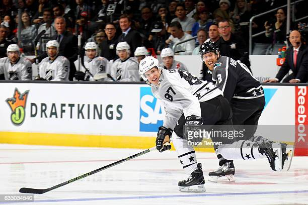 Sidney Crosby of the Pittsburgh Penguins and Joe Pavelski of the San Jose Sharks react during the 2017 Honda NHL AllStar Tournament Final between the...