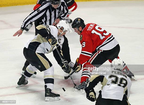 Sidney Crosby of the Pittsburgh Penguins and Jonathan Toews of the Chicago Blackhawks faceoff at the United Center on February 15 2015 in Chicago...