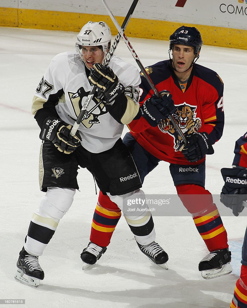 Sidney Crosby #87 of the Pittsburgh Penguins and Mike Weaver #43 of the Florida Panthers battle for position next to the net at the BB&T Center on February 26, 2013 in Sunrise, Florida. The Panthers defeated the Penguins 6-4.
