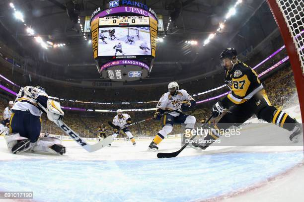 Sidney Crosby of the Pittsburgh Penguins and PK Subban of the Nashville Predators watch as goaltender Pekka Rinne makes a save during the first...
