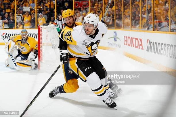 Sidney Crosby of the Pittsburgh Penguins and Roman Josi of the Nashville Predators come together in the corner during Game Six of the 2017 NHL...