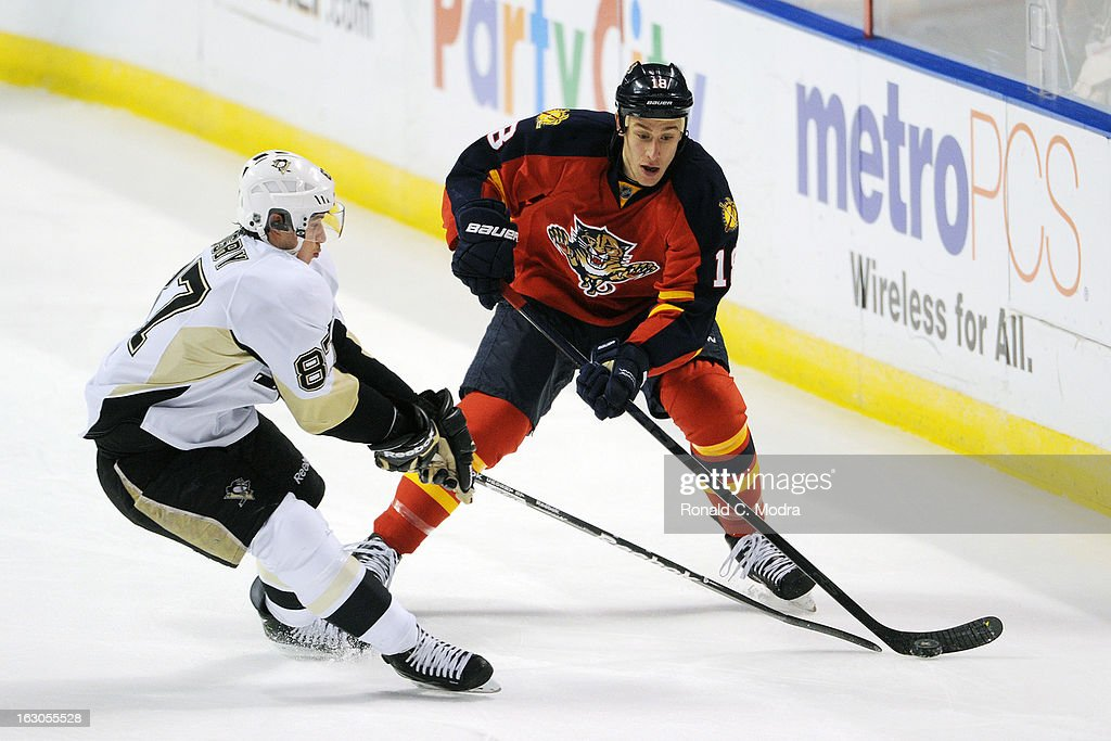 Sidney Crosby #87 of the Pittsburgh Penguins and Shawn Matthias #18 of the Florida Panthers go after the puck during an NHL game at the BB&T Center on February 26, 2013 in Sunrise, Florida.