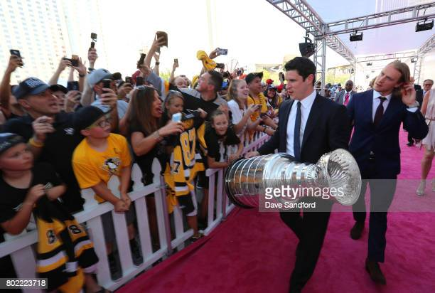 Sidney Crosby of the Pittsburgh Penguins arrives with the Stanley Cup on the magenta carpet for the 2017 NHL Awards at TMobile Arena on June 21 2017...