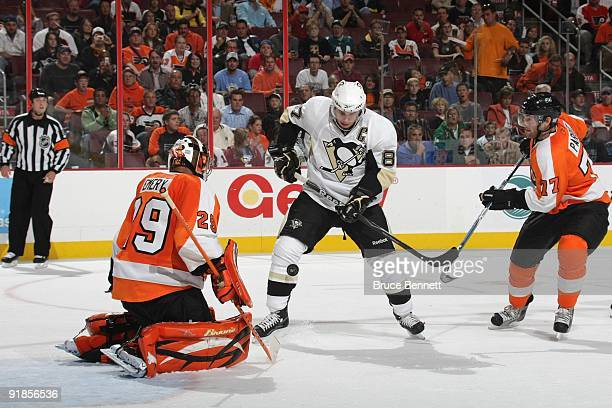Sidney Crosby of the Pittsburgh Penguins attacks the net against Ray Emery and Ryan Parent of the Philadelphia Flyers at the Wachovia Center on...