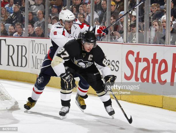 Sidney Crosby of the Pittsburgh Penguins battles against Alex Ovechkin of the Washington Capitals on January 14 2009 at Mellon Arena in Pittsburgh...