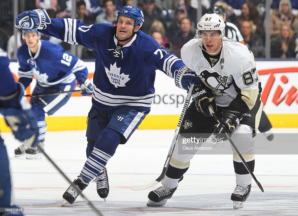 Sidney Crosby #87 of the Pittsburgh Penguins battles against David Clarkson #71 of the Toronto Maple Leafs during an NHL game at the Air Canada Centre on October 26, 2013 in Toronto, Ontario, Canada.