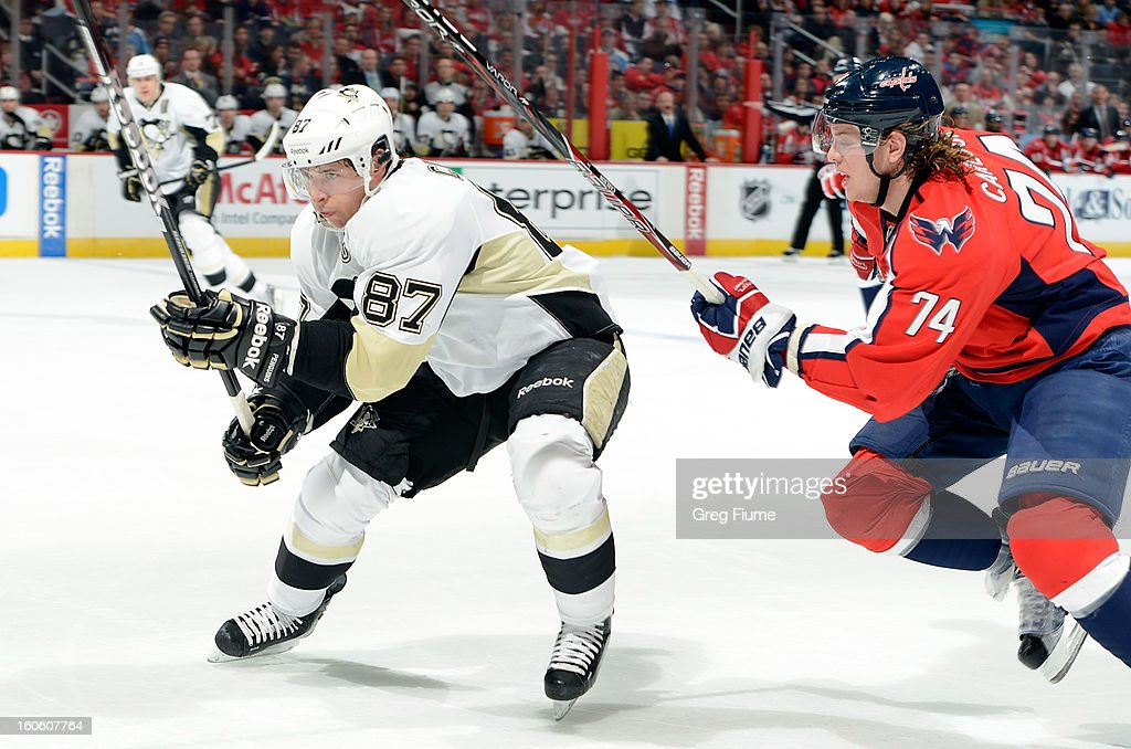 <a gi-track='captionPersonalityLinkClicked' href=/galleries/search?phrase=Sidney+Crosby&family=editorial&specificpeople=212781 ng-click='$event.stopPropagation()'>Sidney Crosby</a> #87 of the Pittsburgh Penguins battles for position against John Carlson #74 of the Washington Capitals at the Verizon Center on February 3, 2013 in Washington, DC.