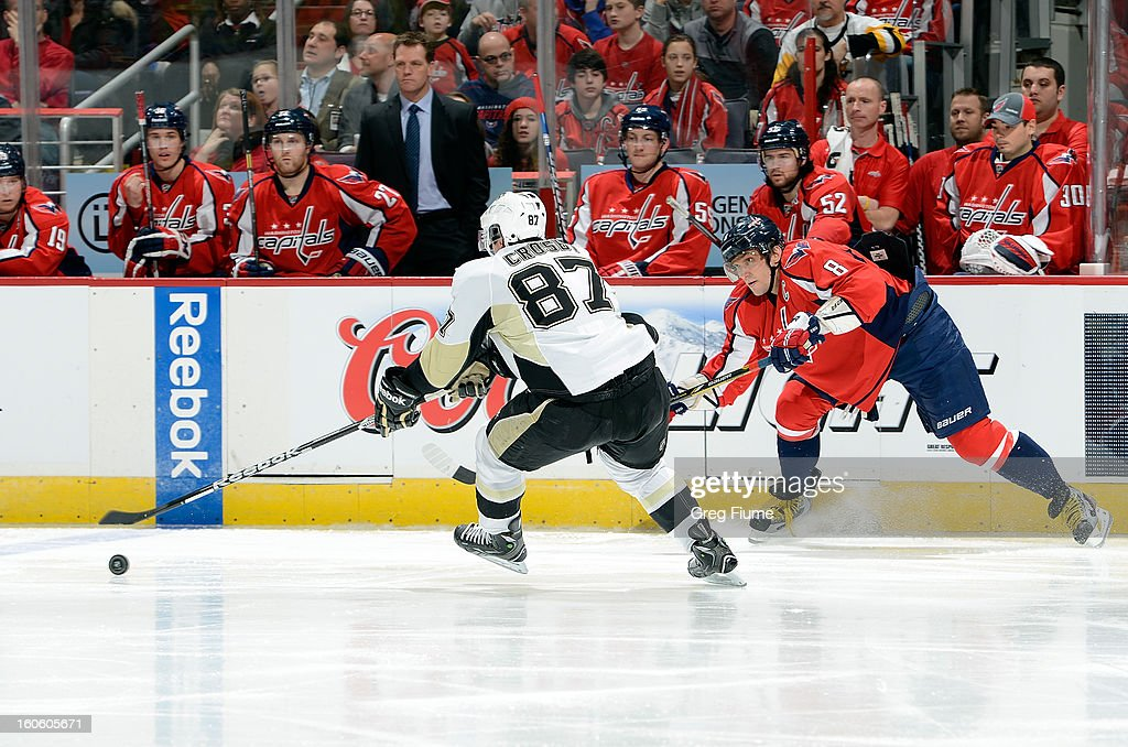 <a gi-track='captionPersonalityLinkClicked' href=/galleries/search?phrase=Sidney+Crosby&family=editorial&specificpeople=212781 ng-click='$event.stopPropagation()'>Sidney Crosby</a> #87 of the Pittsburgh Penguins battles for the puck against Alex Ovechkin #8 of the Washington Capitals at the Verizon Center on February 3, 2013 in Washington, DC.