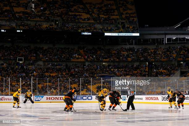Sidney Crosby of the Pittsburgh Penguins beats PierreEdouard Bellemare of the Philadelphia Flyers during a faceoff during the game at Heinz Field on...