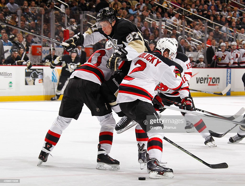 Sidney Crosby of the Pittsburgh Penguins can't get past the defense of Peter Harrold and Marek Zidlicky of the New Jersey Devils at Consol Energy...