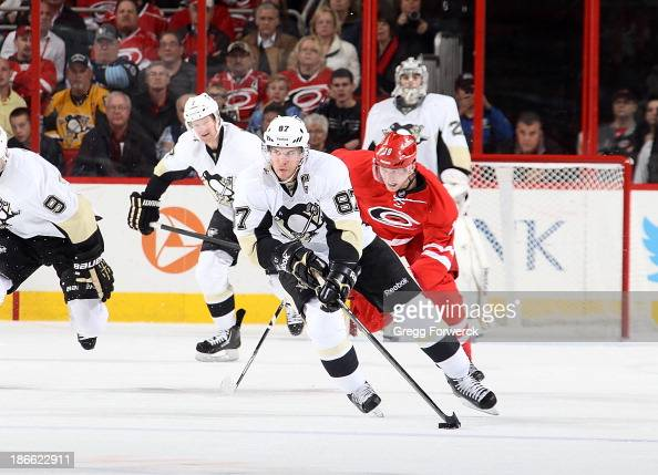 Sidney Crosby of the Pittsburgh Penguins carries the puck during their NHL game against the Carolina Hurricanes at PNC Arena on October 28 2013 in...