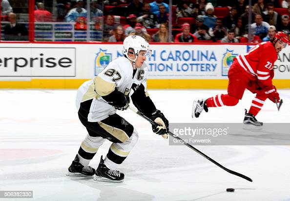 Sidney Crosby of the Pittsburgh Penguins carries the puck through the neutral zone during an NHL game against the Carolina Hurricanes at PNC Arena on...
