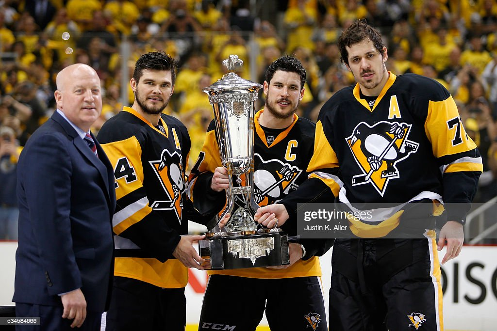 <a gi-track='captionPersonalityLinkClicked' href=/galleries/search?phrase=Sidney+Crosby&family=editorial&specificpeople=212781 ng-click='$event.stopPropagation()'>Sidney Crosby</a> #87 of the Pittsburgh Penguins celebrate by holding the Prince of Wales Trophy with <a gi-track='captionPersonalityLinkClicked' href=/galleries/search?phrase=Chris+Kunitz&family=editorial&specificpeople=604159 ng-click='$event.stopPropagation()'>Chris Kunitz</a> #14, <a gi-track='captionPersonalityLinkClicked' href=/galleries/search?phrase=Evgeni+Malkin&family=editorial&specificpeople=221676 ng-click='$event.stopPropagation()'>Evgeni Malkin</a> #71 and NHL Deputy Commissioner <a gi-track='captionPersonalityLinkClicked' href=/galleries/search?phrase=Bill+Daly&family=editorial&specificpeople=1080836 ng-click='$event.stopPropagation()'>Bill Daly</a> after defeating the Tampa Bay Lightning in Game Seven of the Eastern Conference Final with a score of 2 to 1 during the 2016 NHL Stanley Cup Playoffs at Consol Energy Center on May 26, 2016 in Pittsburgh, Pennsylvania.