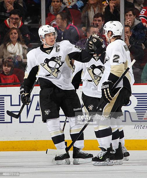 Sidney Crosby of the Pittsburgh Penguins celebrates a Penguins goal with Matt Niskanen during an NHL hockey game against the New Jersey Devils at...